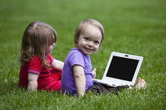 Babies with Notebook Stock Images