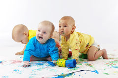 Babies painting royalty free stock images