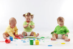 Babies painting. Group of babies painting on white background Stock Photo
