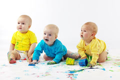 Babies painting Stock Photography