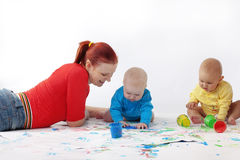 Babies painting with mother Royalty Free Stock Images