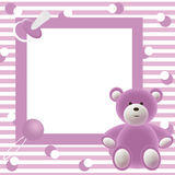 Babies photo frame. Babies pink photo frame with bear, dummy and rattle Royalty Free Stock Photos