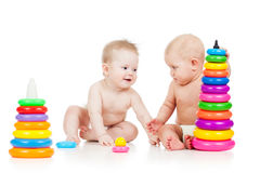 Babies play with developmental toys Royalty Free Stock Photos