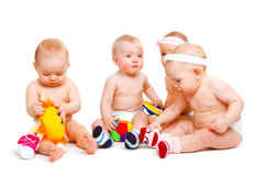 Babies playing. A group of baby boys and girls, playing Royalty Free Stock Photo