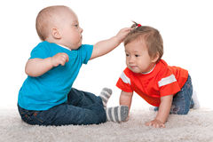 Babies are playing on the carpet Stock Photography