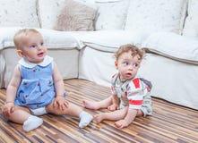Babies playing at home Stock Photos