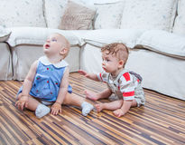 Babies playing at home Stock Photography
