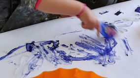 Babies Playing with Paints in Kindergarten Childcare. Children painting with many colors, brushes and rollers. Fun school activities for babies and kids stock video