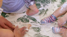 Babies Playing with White Flour in Kindergarten Childcare. Children playing with flour and many colorful toys on the flourbox. Fun school activities for babies stock footage