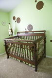 Babies Room. A babies room with green walls and brown dots Royalty Free Stock Images
