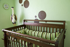 Babies Room. A babies room with green walls and brown dots Stock Image