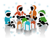 Babies in santa clothes seated in a circle around their gifts. Silhouettes of little cute babies in Santa Claus colorful clothes seated together in a circle Royalty Free Stock Images