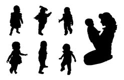 Babies Silhouettes. Six black babies silhouettes and one baby and mother against white background Royalty Free Stock Image