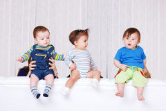 Babies sitting on the sofa back Royalty Free Stock Photo