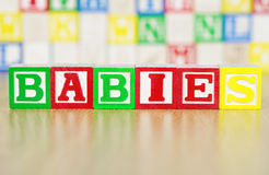 Babies Spelled Out in Alphabet Building Blocks Stock Images