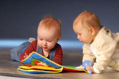 Babies with toys. Babies playing with toys on floor Stock Photography