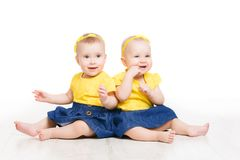 Babies Twins, Two Kids Girls Sitting on Floor, Sisters Children royalty free stock photos