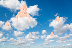 Babies on White clouds in blue sky collage Royalty Free Stock Photography