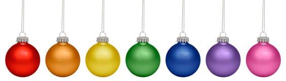 Babioles de Noël toutes les couleurs de l'arc-en-ciel d'isolement sur le blanc Photos stock