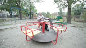 Grandma spinning on a swing. stock video footage