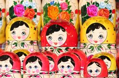 Babushka Russian traditional nesting dolls in various Royalty Free Stock Images