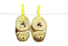 Baby's bootee. Baby's bootee – bears hanging on the clothesline Stock Photos