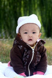 Baby. The cute baby is smiling Royalty Free Stock Photo