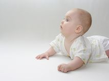 Baby. Half year lies on white Royalty Free Stock Images