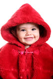 Baby. Beautiful baby with red hood over white background Royalty Free Stock Images
