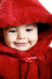 Baby. Looking down, baby with red hood over white background Stock Image