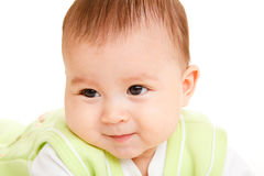 Baby. Cute Hispanic baby looking aside Stock Photo