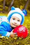 Baby. Cute one year old baby on the grass with a ball Royalty Free Stock Photo
