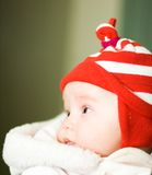 Baby. In red hat Stock Images
