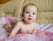 Baby. Funny naked girl lying on her stomach Royalty Free Stock Image