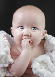 Baby. Teething baby girl big blue eyes stock image