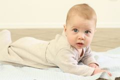 Baby. A beautiful baby boy on his tummy Royalty Free Stock Photo