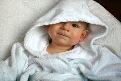 The baby. In a dressing gown of 7 months Royalty Free Stock Photography