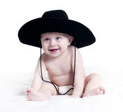 Baby. Portrait of baby in a big hat on a white studio background Royalty Free Stock Images