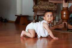 Baby. Girl crawling on the floor Royalty Free Stock Photos