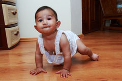 Baby. Girl crawling on the floor Stock Images
