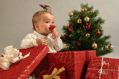 Baby. Cute little girl with presents Stock Photos
