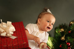 Baby. Cute little girl with presents Stock Image