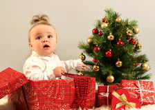 Baby. Cute little girl with presents Stock Images