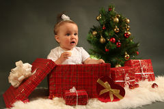 Baby. Cute little girl with presents Royalty Free Stock Image