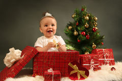 Baby. Cute little girl with presents Royalty Free Stock Photography