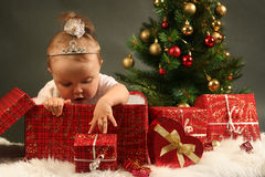 Baby. Cute little girl with presents Royalty Free Stock Photos