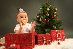 Baby. Cute little girl with presents Stock Photography