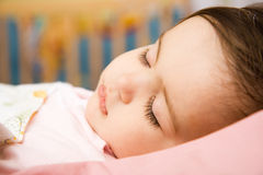 Baby. Sleeping sweetly in bad Royalty Free Stock Image