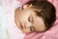 Baby. Sleeping sweetly in bad Royalty Free Stock Photography