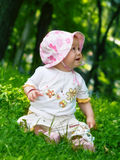 Baby. Playing in the park royalty free stock image